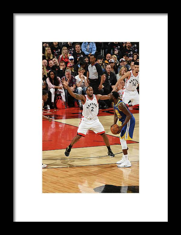 Playoffs Framed Print featuring the photograph Draymond Green and Kawhi Leonard by Ron Turenne