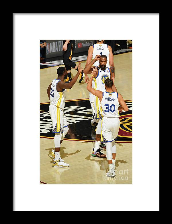 Playoffs Framed Print featuring the photograph Draymond Green, Stephen Curry, and Kevin Durant by Jesse D. Garrabrant