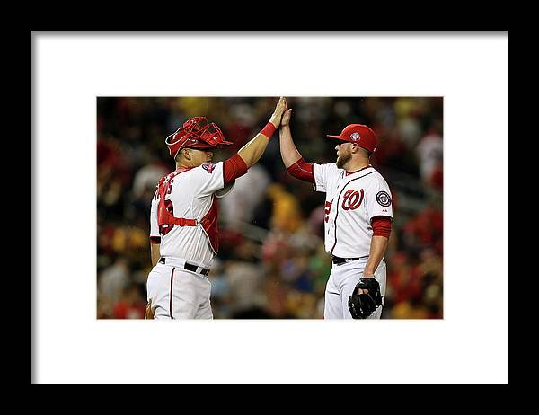 Drew Storen Framed Print featuring the photograph Drew Storen and Wilson Ramos by Patrick Smith