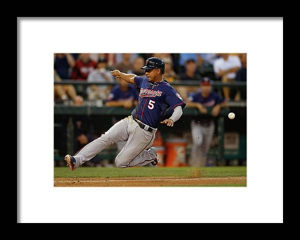 American League Baseball Framed Print featuring the photograph Dustin Ackley, Eduardo Escobar, and Brian Dozier by Otto Greule Jr