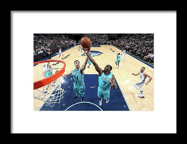 Nba Pro Basketball Framed Print featuring the photograph Dwayne Bacon and Frank Kaminsky by Joe Murphy