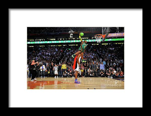 Nba Pro Basketball Framed Print featuring the photograph Dwight Howard and Nate Robinson by Jesse D. Garrabrant