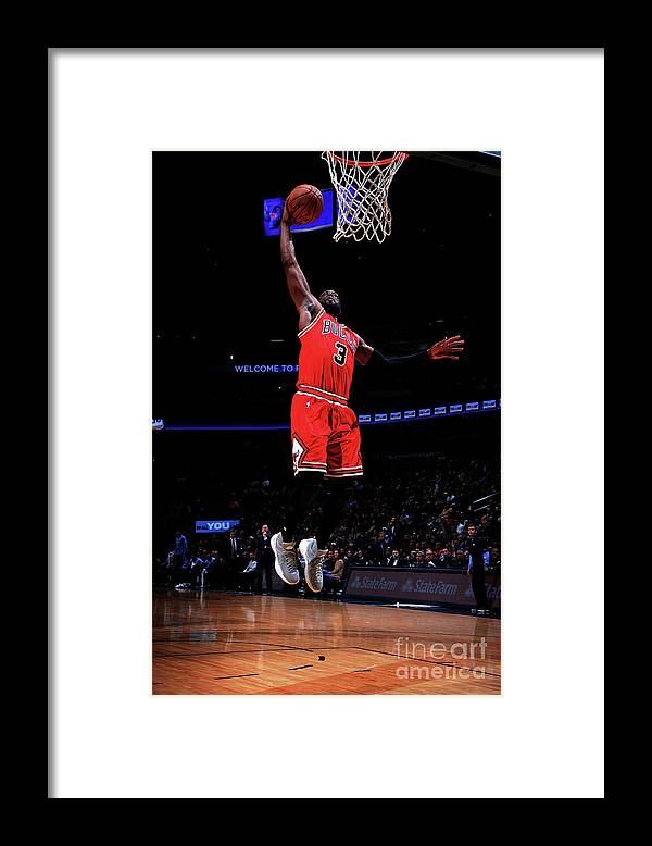 Nba Pro Basketball Framed Print featuring the photograph Dwyane Wade by Bart Young