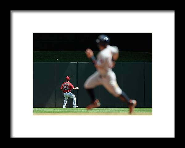 People Framed Print featuring the photograph Eddie Rosario and Carlos Correa by Hannah Foslien