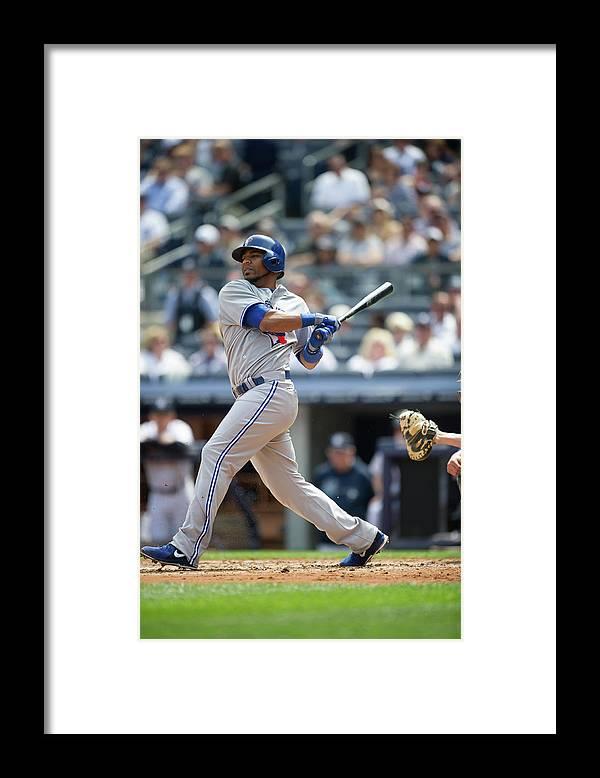American League Baseball Framed Print featuring the photograph Edwin Encarnacion by Rob Tringali