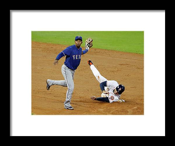 American League Baseball Framed Print featuring the photograph Elvis Andrus and George Springer by Scott Halleran