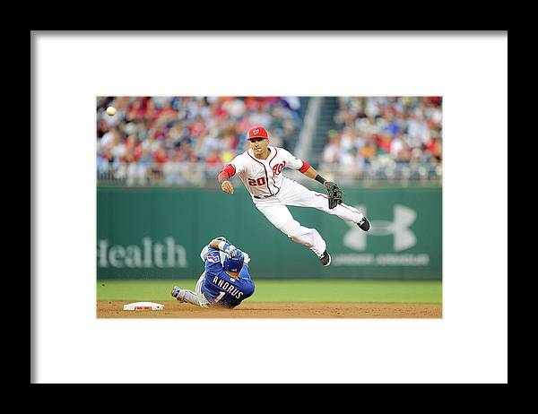 American League Baseball Framed Print featuring the photograph Elvis Andrus and Ian Desmond by Greg Fiume