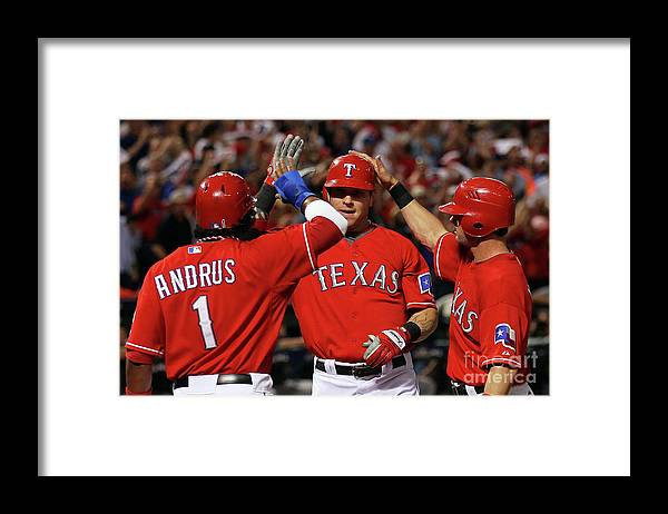 Playoffs Framed Print featuring the photograph Elvis Andrus, Michael Young, and Josh Hamilton by Stephen Dunn