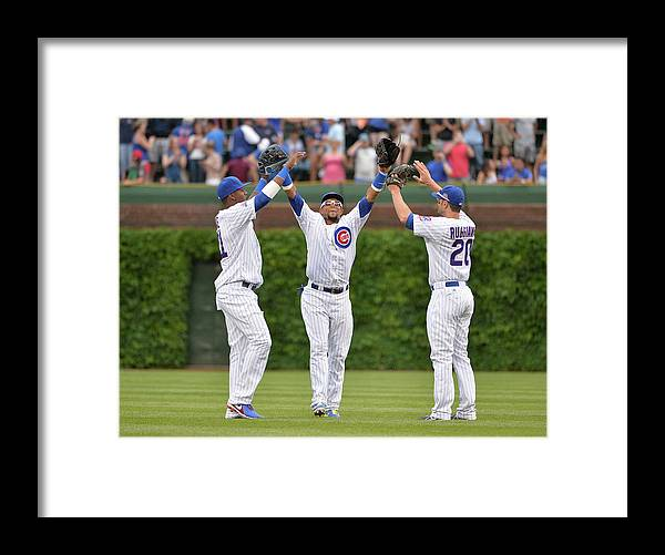 Celebration Framed Print featuring the photograph Emilio Bonifacio and Justin Ruggiano by Brian Kersey