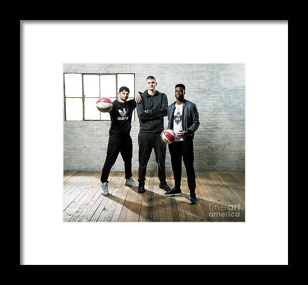 Nba Pro Basketball Framed Print featuring the photograph Emmanuel Mudiay and Jamal Murray by Nathaniel S. Butler