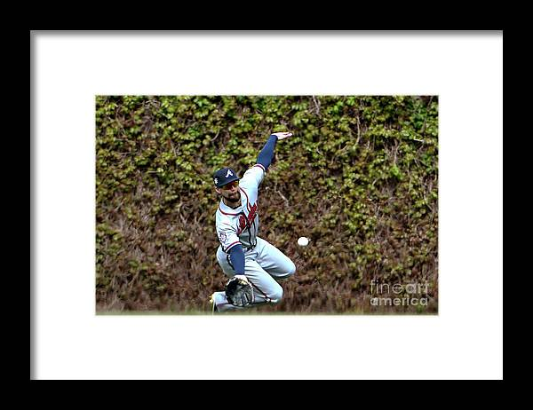 People Framed Print featuring the photograph Ender Inciarte and Javier Baez by David Banks