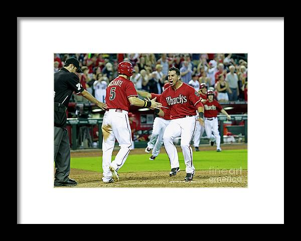 American League Baseball Framed Print featuring the photograph Ender Inciarte, David Peralta, and Paul Goldschmidt by Ralph Freso