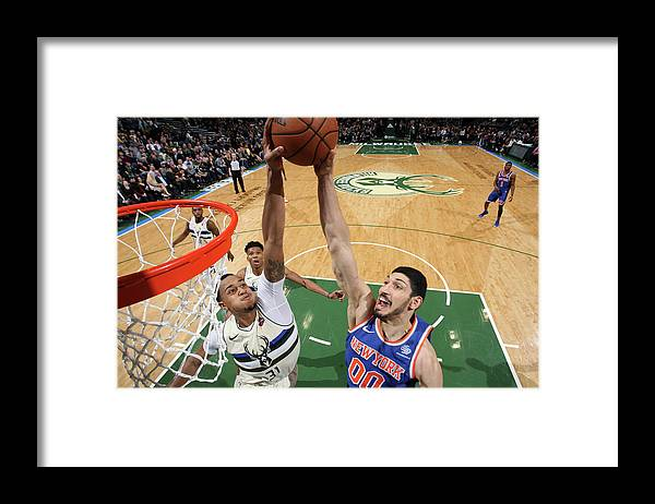 Nba Pro Basketball Framed Print featuring the photograph Enes Kanter and John Henson by Gary Dineen