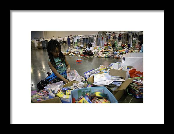 Child Framed Print featuring the photograph Epic Flooding Inundates Houston After Hurricane Harvey by Win McNamee