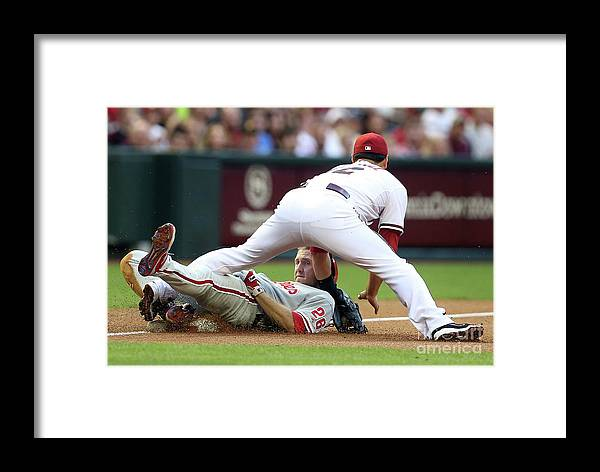 Eric Chavez Framed Print featuring the photograph Eric Chavez And Chase Utley by Christian Petersen