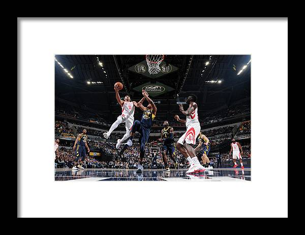 Nba Pro Basketball Framed Print featuring the photograph Eric Gordon by Ron Hoskins