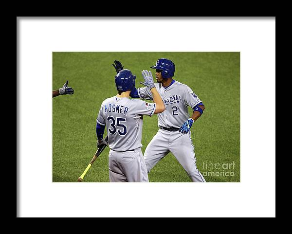 Three Quarter Length Framed Print featuring the photograph Eric Hosmer and Alcides Escobar by Vaughn Ridley
