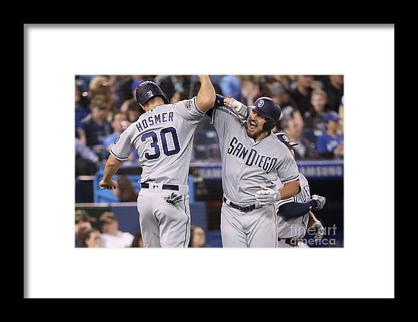 People Framed Print featuring the photograph Eric Hosmer And Hunter Renfroe by Tom Szczerbowski