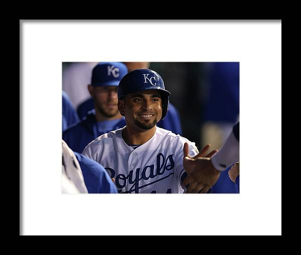 American League Baseball Framed Print featuring the photograph Eric Hosmer and Omar Infante by Ed Zurga