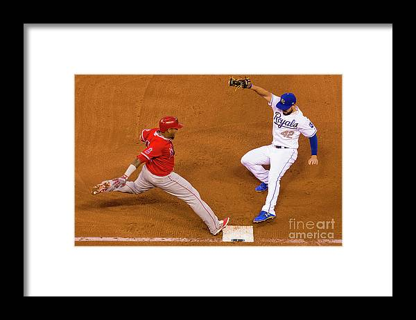 People Framed Print featuring the photograph Eric Hosmer and Yunel Escobar by Kyle Rivas