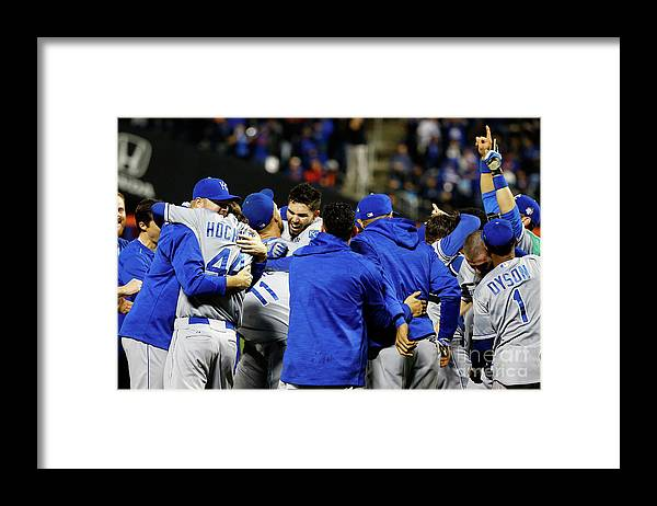 People Framed Print featuring the photograph Eric Hosmer, Drew Butera, and Wade Davis by Al Bello