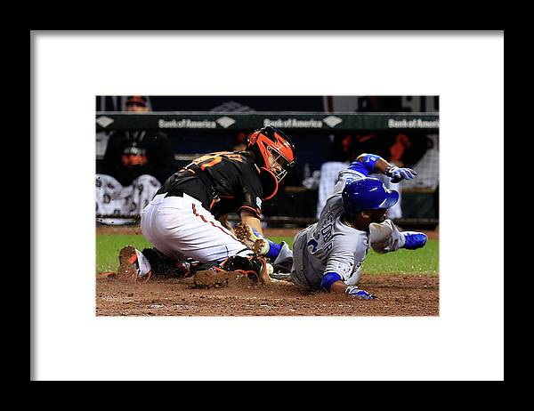 Ninth Inning Framed Print featuring the photograph Eric Hosmer, Nick Hundley, and Alcides Escobar by Rob Carr