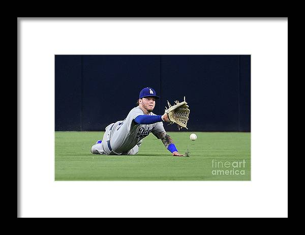 Game Two Framed Print featuring the photograph Erick Aybar and Alex Verdugo by Denis Poroy
