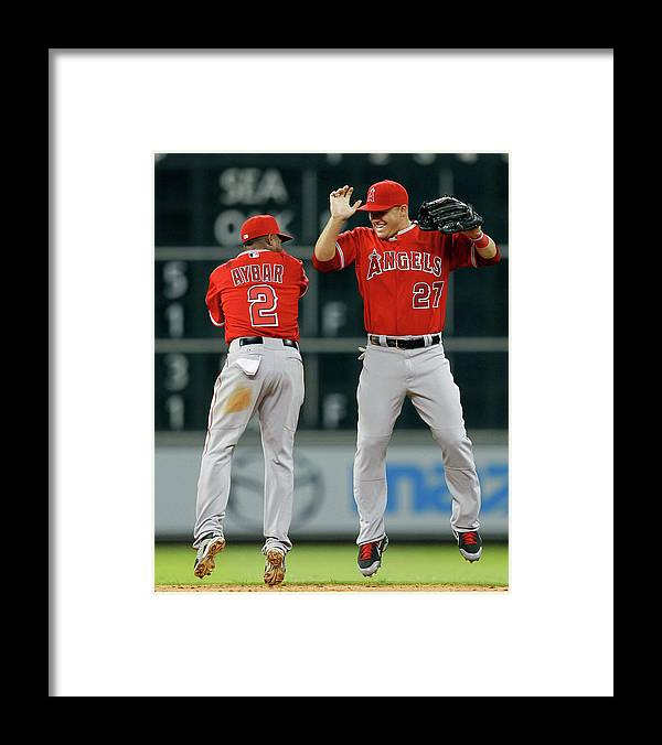 American League Baseball Framed Print featuring the photograph Erick Aybar and Mike Trout by Bob Levey