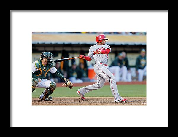 Following Framed Print featuring the photograph Erick Aybar and Stephen Vogt by Brian Bahr