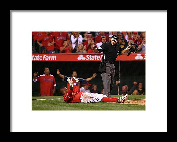 People Framed Print featuring the photograph Erick Aybar and Tyson Ross by Victor Decolongon
