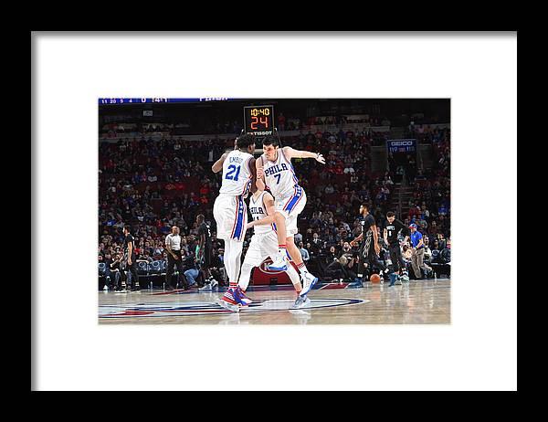 Nba Pro Basketball Framed Print featuring the photograph Ersan Ilyasova and Joel Embiid by Jesse D. Garrabrant