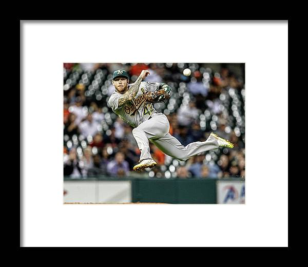 Evan Gattis Framed Print featuring the photograph Evan Gattis And Brett Lawrie by Bob Levey