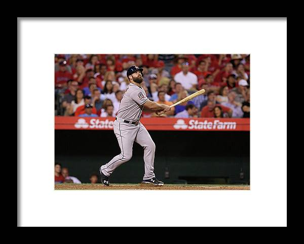 Evan Gattis Framed Print featuring the photograph Evan Gattis and George Springer by Stephen Dunn