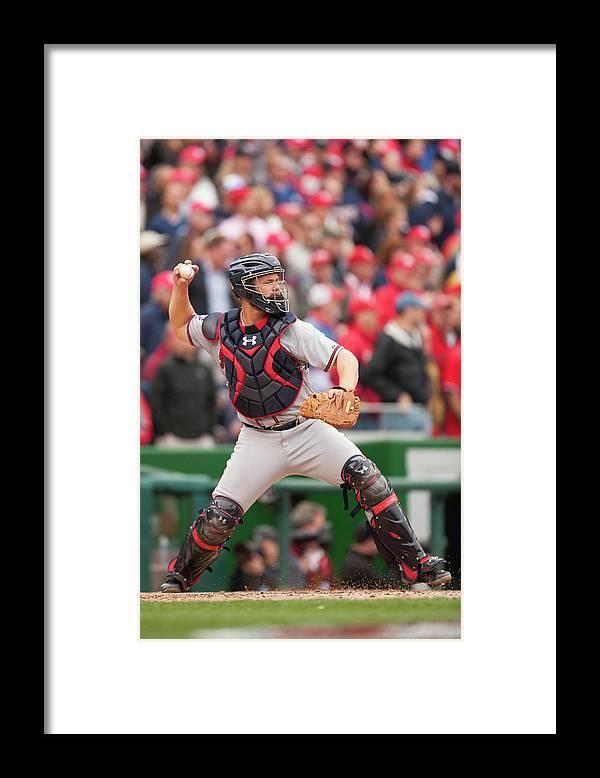 Evan Gattis Framed Print featuring the photograph Evan Gattis by Mitchell Layton