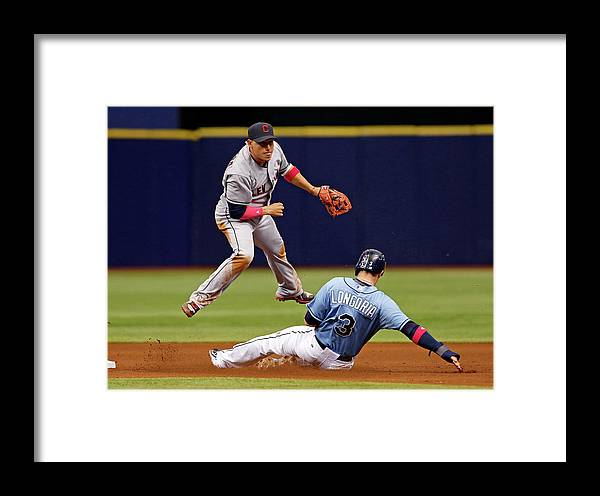 Following Framed Print featuring the photograph Evan Longoria And Asdrubal Cabrera by Mike Carlson