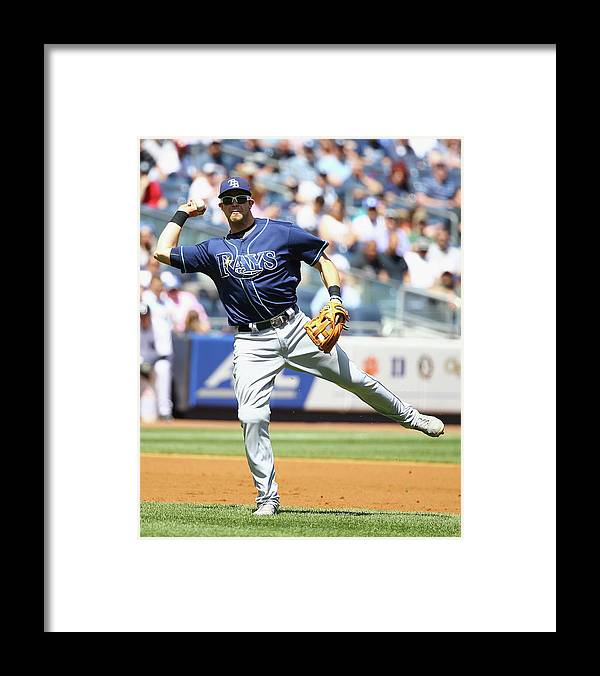 American League Baseball Framed Print featuring the photograph Evan Longoria and Chase Headley by Al Bello