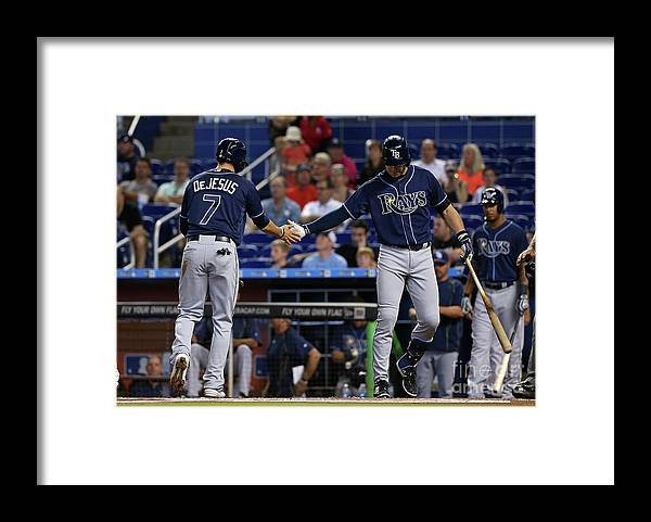 American League Baseball Framed Print featuring the photograph Evan Longoria and David Dejesus by Mike Ehrmann