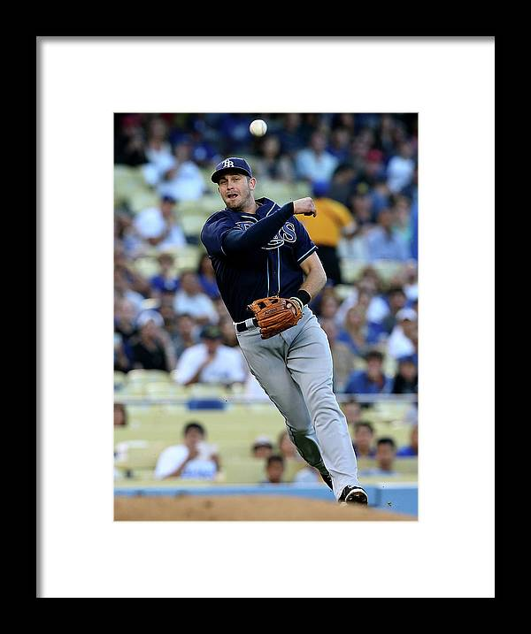 American League Baseball Framed Print featuring the photograph Evan Longoria and Mark Ellis by Stephen Dunn