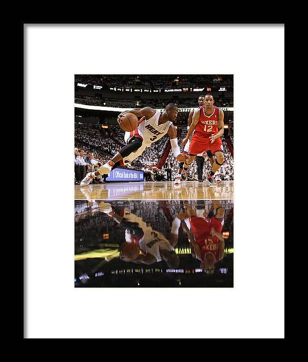 Playoffs Framed Print featuring the photograph Evan Turner and Dwyane Wade by Mike Ehrmann