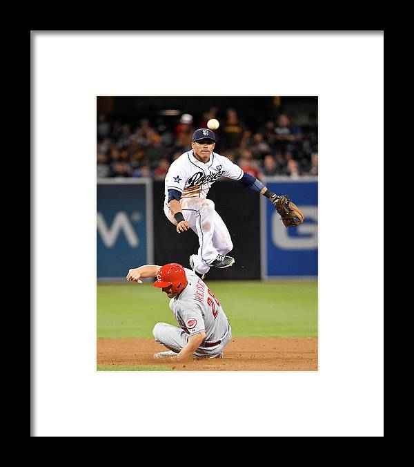 Double Play Framed Print featuring the photograph Everth Cabrera and Chris Heisey by Denis Poroy