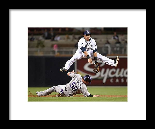 Double Play Framed Print featuring the photograph Everth Cabrera and Jordan Pacheco by Denis Poroy