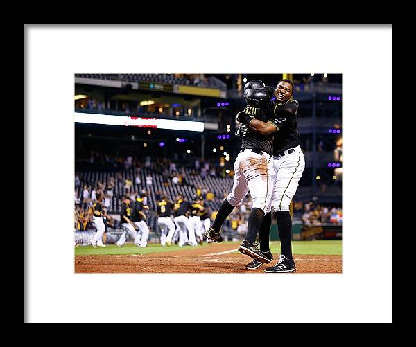 People Framed Print featuring the photograph Francisco Cervelli and Gregory Polanco by Jared Wickerham