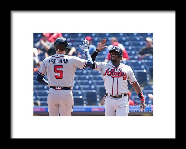 Three Quarter Length Framed Print featuring the photograph Freddie Freeman and Brandon Phillips by Mitchell Leff
