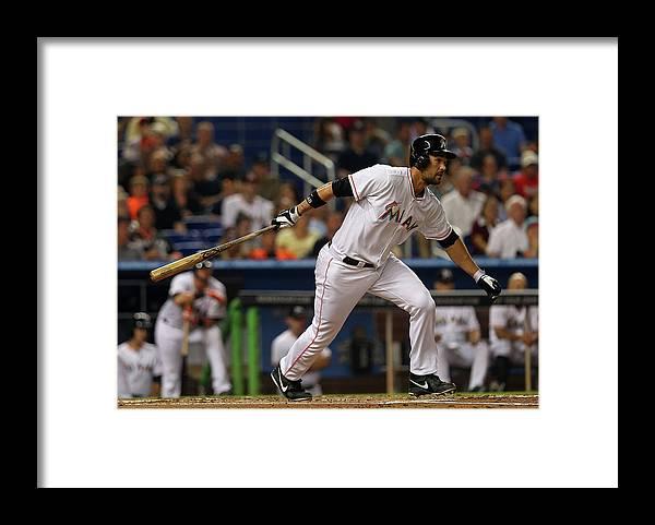 American League Baseball Framed Print featuring the photograph Garrett Jones by Mike Ehrmann