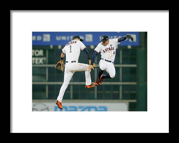 People Framed Print featuring the photograph George Springer and Carlos Correa by Bob Levey