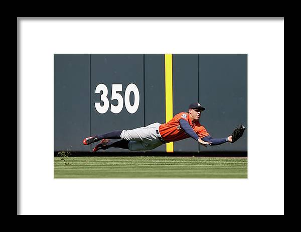 People Framed Print featuring the photograph George Springer and Dj Lemahieu by Doug Pensinger
