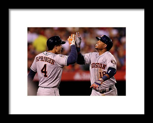 People Framed Print featuring the photograph George Springer and Luis Valbuena by Stephen Dunn
