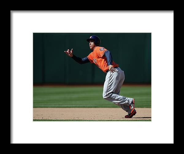 American League Baseball Framed Print featuring the photograph George Springer by Brad Mangin