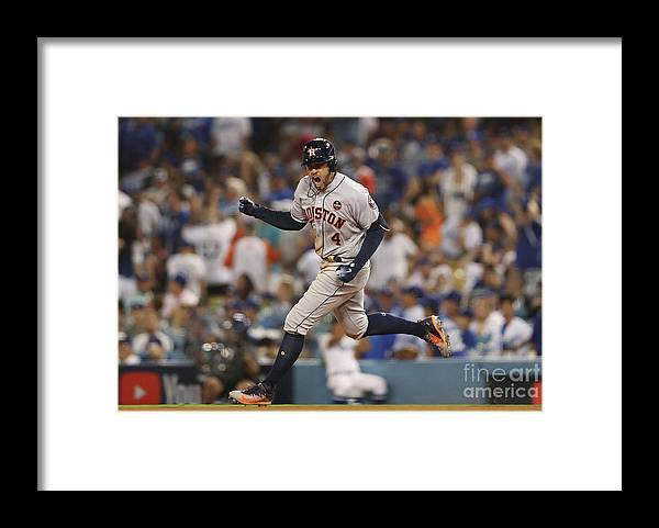 Game Two Framed Print featuring the photograph George Springer by Christian Petersen