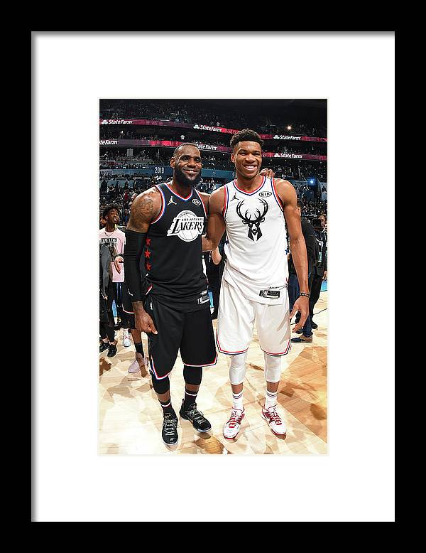 Nba Pro Basketball Framed Print featuring the photograph Giannis Antetokounmpo and Lebron James by Andrew D. Bernstein